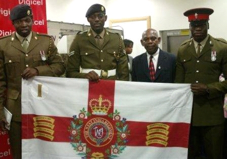 Boys of British Army standing beside a veteran who served in the Warwickshire's