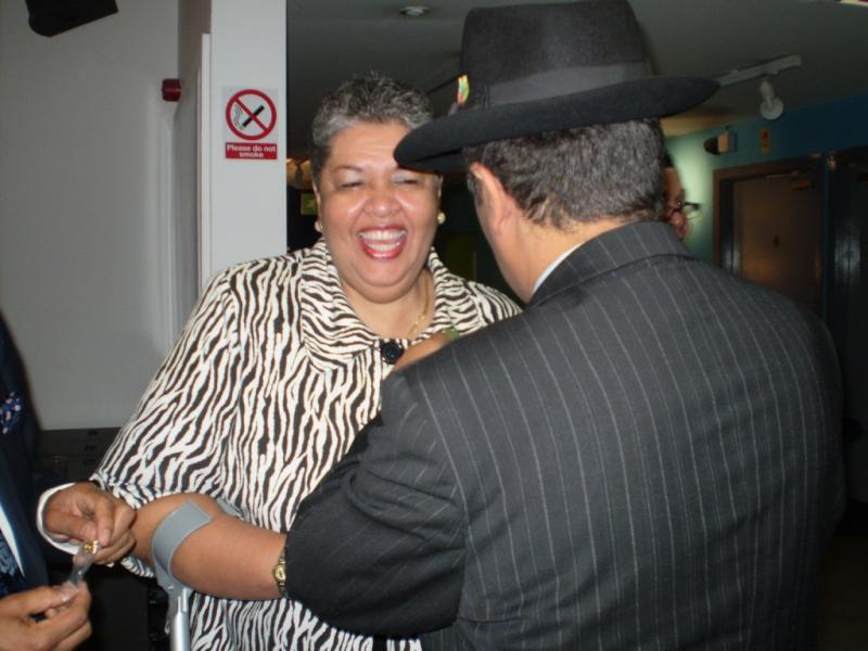 Jamaican High Commissioner receiving her WAWI Pin Badge